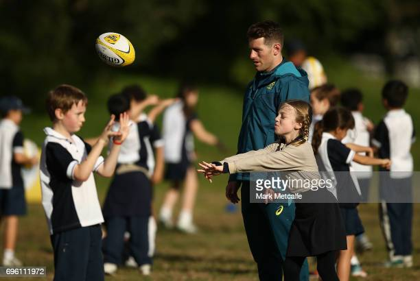 Bernard Foley instructs local school children during an Australian Wallabies media opportunity at Lough Playing Fields on June 15 2017 in Sydney...