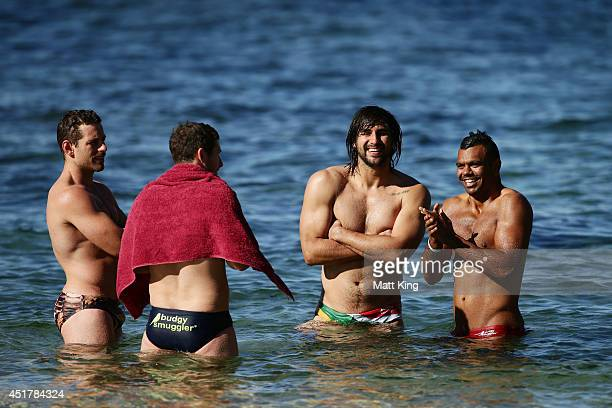 Bernard Foley Jacques Potgieter and Kurtley Beale take part in a Waratahs Super Rugby recovery session at Clovelly Beach on July 7 2014 in Sydney...