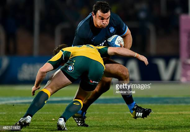 Bernard Foley of Australia and Ramiro Herrera of Argentina compete for the ball during a match between Australia and Argetina as part of The Rugby...