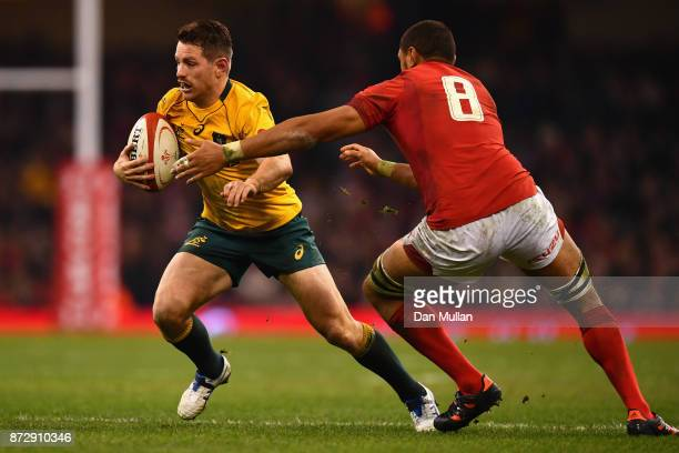 Bernard Foley of Australia attempts to get away from Taulupe Faletau of Wales during the Under Armour Series match between Wales and Australia at...