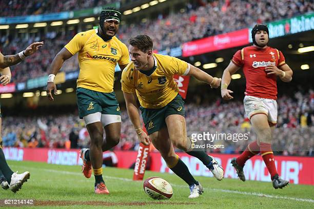 Bernard Foley of Australia celebrates after scoring his team's fourth try during the international match between Wales and Australia at the...