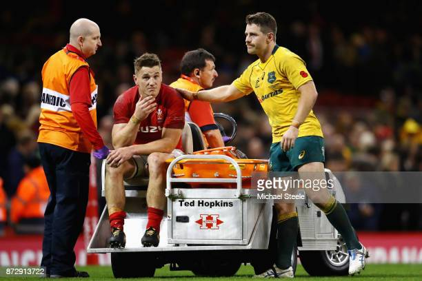 Bernard Foley of Australia checks that Jonathan Davies of Wales is okay after he was stretched off injured after the Under Armour Series match...