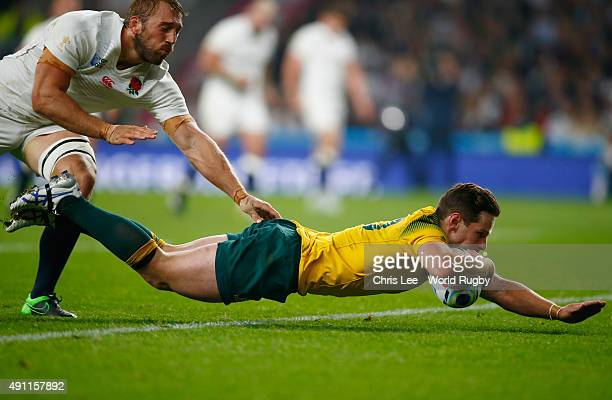 Bernard Foley of Australia evades Chris Robshaw of England and dives over the line to score the first try during the 2015 Rugby World Cup Pool A...