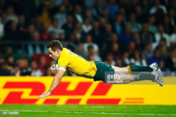 Bernard Foley of Australia goes over to score their second try during the 2015 Rugby World Cup Pool A match between England and Australia at...