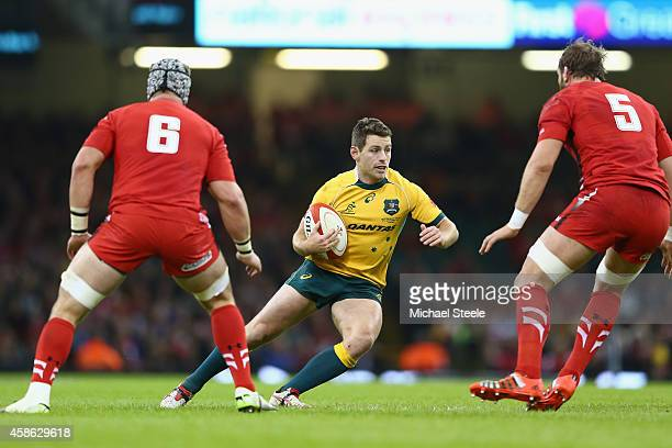 Bernard Foley of Australia is closed down by Dan Lydiate and Alun Wyn Jones of Wales during the International match between Wales and Australia at...