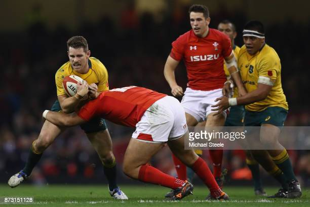 Bernard Foley of Australia is tackled by Leon Brown of Wales during the Autumn International between Wales and Australia at the Principality Stadium...
