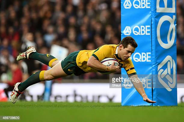 Bernard Foley of Australia scores his team's first try during the QBE international match between England and Australia at Twickenham Stadium on...