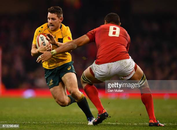 Bernard Foley of Australia takes on Taulupe Faletau of Wales during the Under Armour Series 2017 match between Wales and Australia at the...