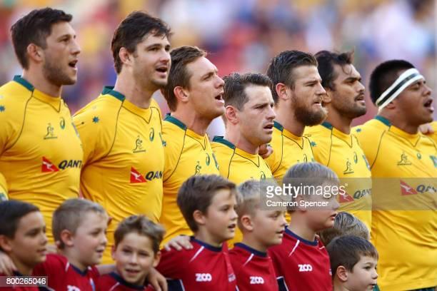 Bernard Foley of the Wallabies and team mates sing the Australian national anthem during the International Test match between the Australian...