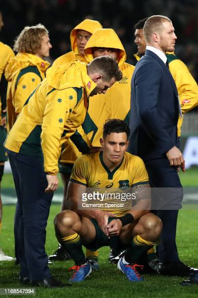 Bernard Foley of the Wallabies consoles team mate Matt To'omua of the Wallabies after losing The Rugby Championship and Bledisloe Cup Test match...