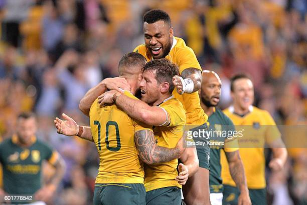 Bernard Foley of the Wallabies is congratulated by team mates after scoring a try during the Rugby Championship match between the Australian...