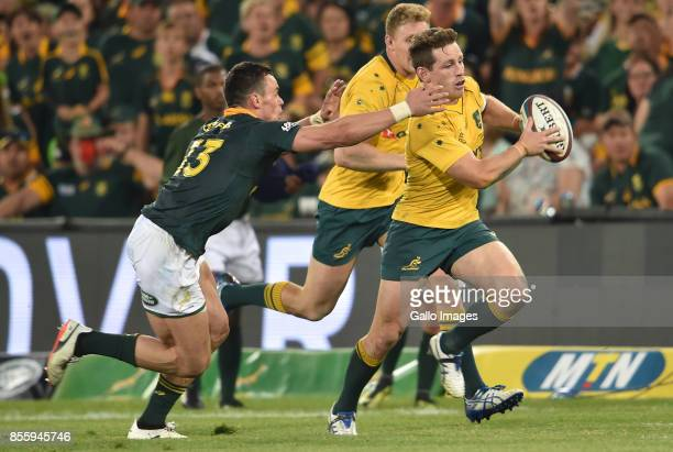 Bernard Foley of the Wallabies is pursued by Jesse Kriel of the Springboks during the Rugby Championship 2017 match between South Africa and...