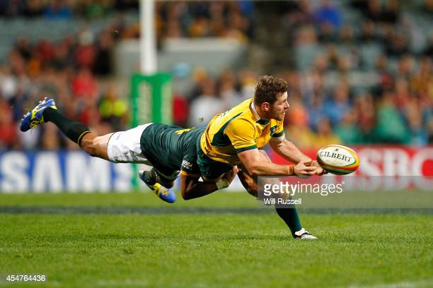 Bernard Foley of the Wallabies is tackled by Cornal Hendricks of the Springboks during The Rugby Championship match between the Australian Wallabies...