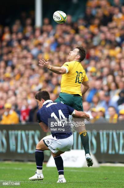 Bernard Foley of the Wallabies jumps for a high ball and is tackled by Lee Jones of Scotland during the International Test match between the...