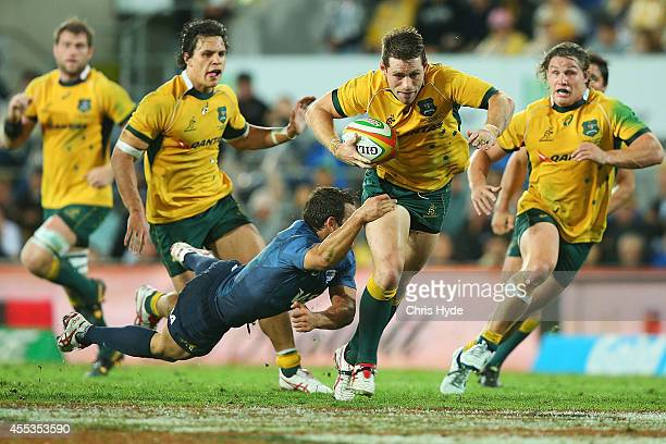 Bernard Foley of the Wallabies makes a break during The Rugby Championship match between the Australian Wallabies and Argentina at Cbus Super Stadium...