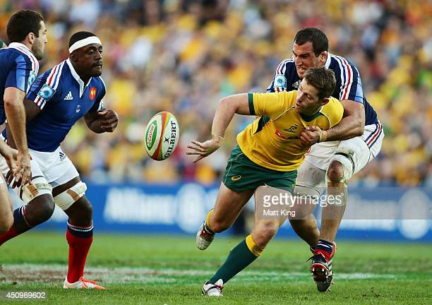 Bernard Foley of the Wallabies offloads the ball in a tackle during the International Test match between the Australian Wallabies and France at...