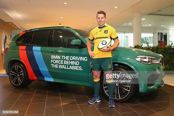 Bernard Foley of the Wallabies poses with a BMW following a major partnership announcement between Australian Rugby Union and BMW during a press...