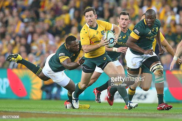 Bernard Foley of the Wallabies runs the ball during the Rugby Championship match between the Australian Wallabies and the South Africa Springboks at...