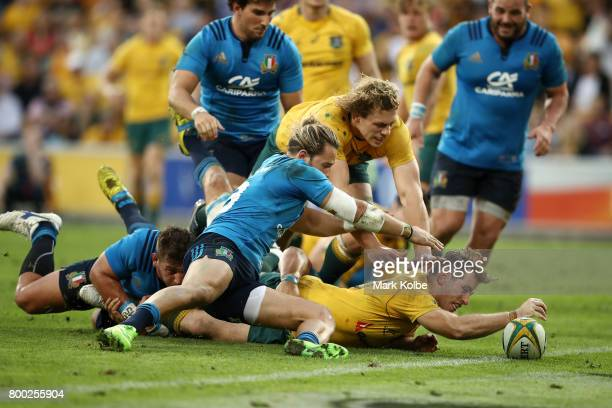 Bernard Foley of the Wallabies scores a try during the International Test match between the Australian Wallabies and Italy at Suncorp Stadium on June...