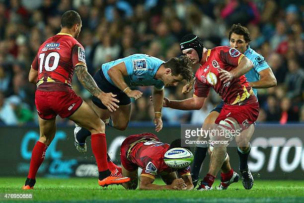 Bernard Foley of the Waratahs and Will Genia of the Reds contest the ball during the round 18 Super Rugby match between the Waratahs and the Reds at...