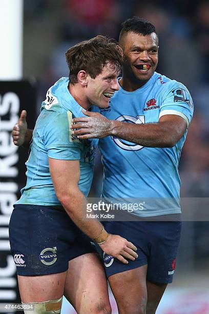 Bernard Foley of the Waratahs celebrates with his team mate Kurtley Beale of the Waratahs after scoring a try during the round 15 Super Rugby match...