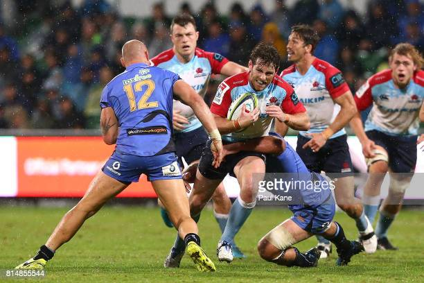 Bernard Foley of the Waratahs gets tackled by Billy Meakes and Matt Hodgson of the Force during the round 17 Super Rugby match between the Force and...