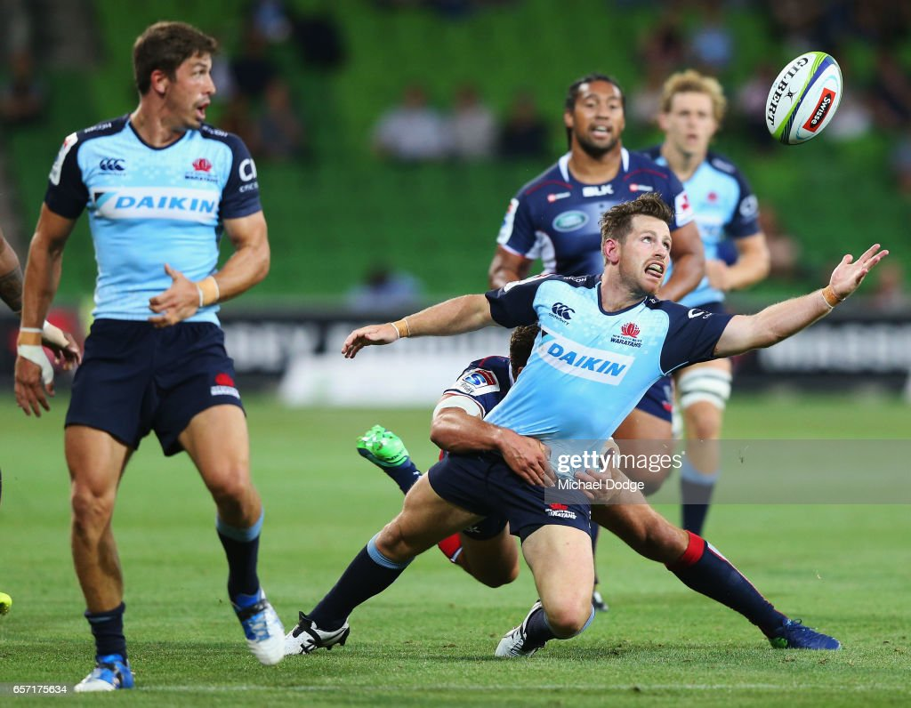 Bernard Foley of the Waratahs is tackled by Tom English of the Rebels during the round five Super Rugby match between the Rebels and the Waratahs at AAMI Park on March 24, 2017 in Melbourne, Australia.