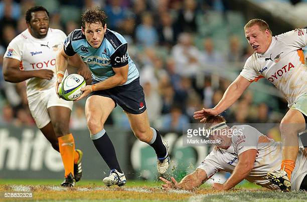 Bernard Foley of the Waratahs makes a break to score a try during the round 11 Super Rugby match between the Waratahs and the Cheetahs at Allianz...