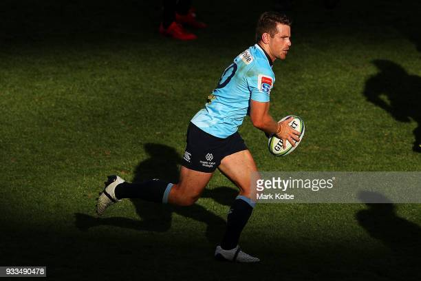 Bernard Foley of the Waratahs runs the ball during the round five Super Rugby match between the Waratahs and the Rebels at Allianz Stadium on March...