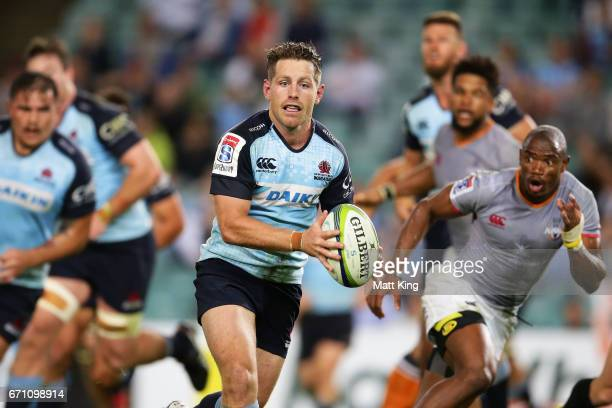Bernard Foley of the Waratahs runs with the ball during the round nine Super Rugby match between the Waratahs and the Kings at Allianz Stadium on...
