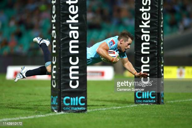 Bernard Foley of the Waratahs scores a try during the round 10 Super Rugby match between the Waratahs and the Melbourne Rebels at the Sydney Cricket...