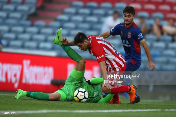 Bernard Fornaroli of Melbourne City contests the ball with Jack Duncan of the Jets during the round 25 ALeague match between the Newcastle Jets and...