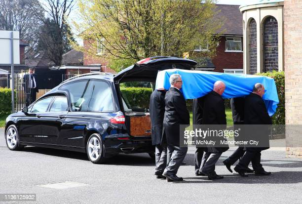 Bernard Halford's coffin is carried into the service at the Funeral of Manchester City Life President Bernard Halford at St Mary's Church in...