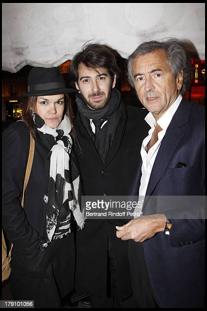 Bernard Henri Levy with son Antonin and his wife at The 20th Anniversary Of La Regle Du Jeu Celebrated At The Cafe De Flore In Paris