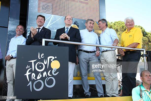 Bernard Hinault Christian Estrosi mayor of Nice Prince Albert of Monaco Eddy Merckx Bernard Hinault and Raymond Poulidor stand on the podium after...