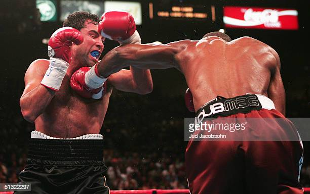 Bernard Hopkins connects with a punch to Oscar De La Hoya during their world middleweight championship at the MGM Grand Garden Casino on September 18...