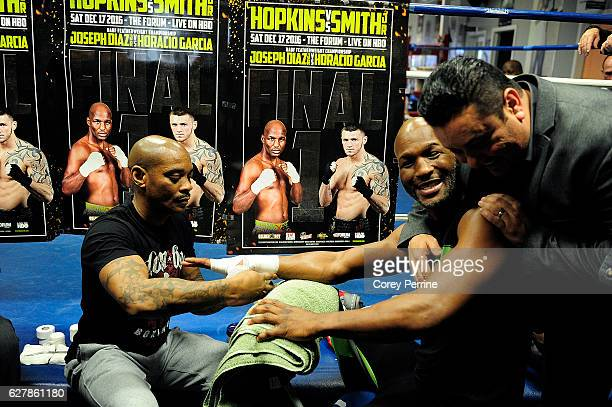 Bernard Hopkins is hugged by an acquaintance while being taped by Assistant Trainer Danny Davis during a media workout at the Joe Hand Boxing Gym on...
