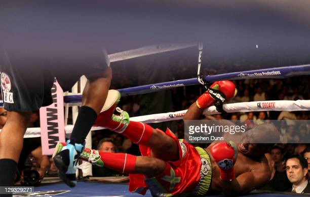 Bernard Hopkins lands on the canvas after tangling with Chad Dawson in the second round in their WBC and Ring Magzine light heavyweight title fight...