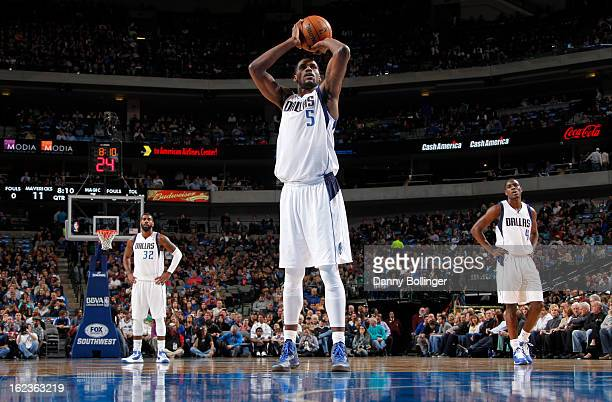 Bernard James of the Dallas Mavericks attempts a foul shot against the Orlando Magic on February 20 2013 at the American Airlines Center in Dallas...