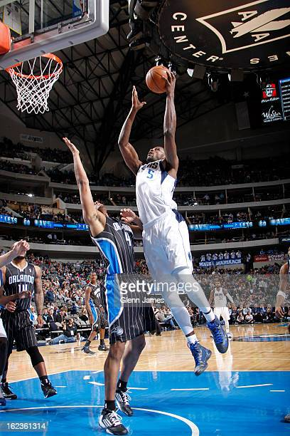 Bernard James of the Dallas Mavericks drives to the basket against the Orlando Magic on February 20 2013 at the American Airlines Center in Dallas...