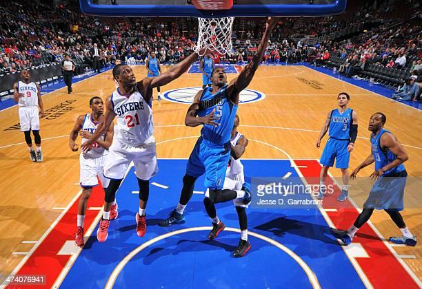 Bernard James of the Dallas Mavericks grabs the rebound against the Philadelphia 76ers at the Wells Fargo Center on February 21 2014 in Philadelphia...