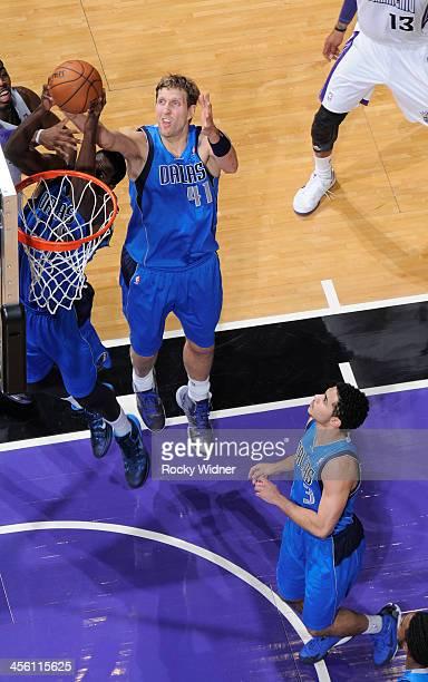 Bernard James of the Dallas Mavericks rebounds against the Sacramento Kings on December 9 2013 at Sleep Train Arena in Sacramento California NOTE TO...