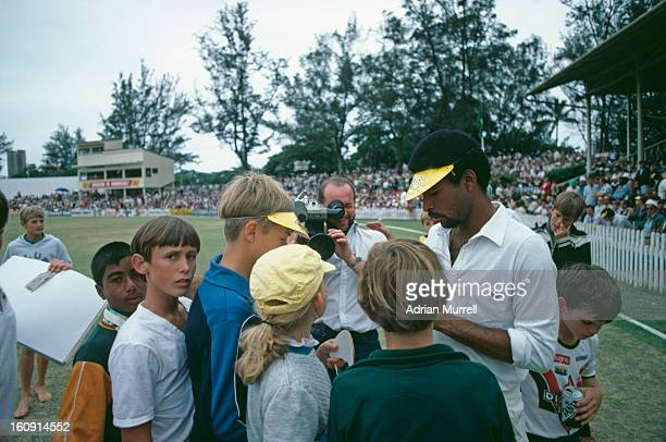 Bernard Julien of the rebel West Indies XI signs autographs during a oneday international against South Africa in Durban during the team's tour of...