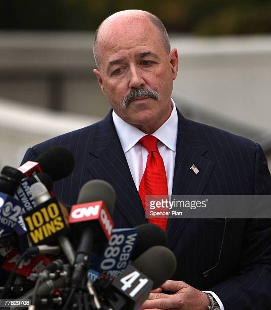 Bernard Kerik stands near microphones after speaking to the media following a court appearance on corruption charges November 9, 2007 in White...