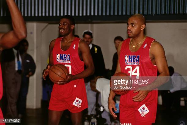 Bernard King and Charles Barkley of the Eastern Conference AllStars shoots the ball during NBA AllStar Practice as part of the 1991 All Star Weekend...