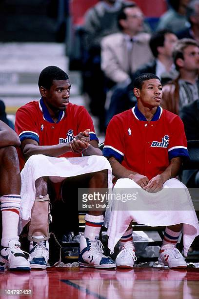 Bernard King and Muggsy Bogues of the Washington Bullets sit on the bench against the Portland Trail Blazers during a game played circa 1987 at the...