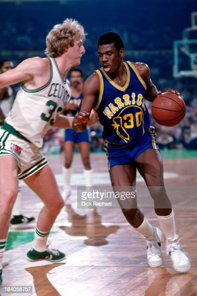 Bernard King of the Golden State Warriors dribbles the ball against Larry Bird of the Boston Celtics during a game played circa 1980 at the Boston...