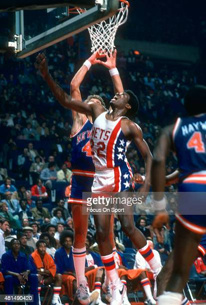 Bernard King of the New Jersey Nets in action against the New York Knicks during an NBA basketball game circa 1977 at the Rutgers Athletic Center in...