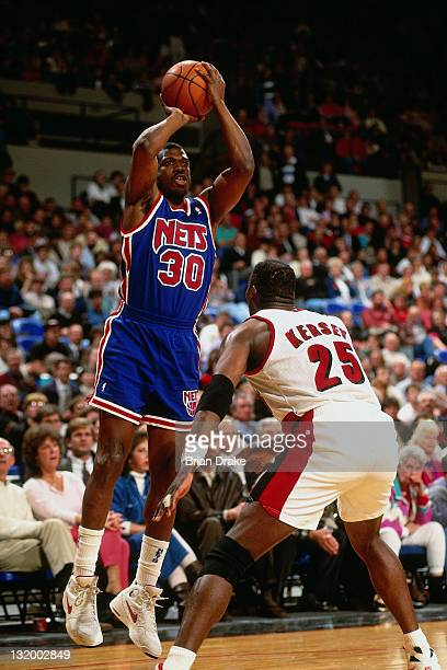 Bernard King of the New Jersey Nets shoots against Jerome Kersey of the Portland Trailblazers at the Veterans Memorial Coliseum circa 1993 in...