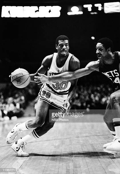 Bernard King of the New York Knicks dribbles against the New Jersey Nets during the NBA game at Madison Square Garden New York City New York NOTE TO...